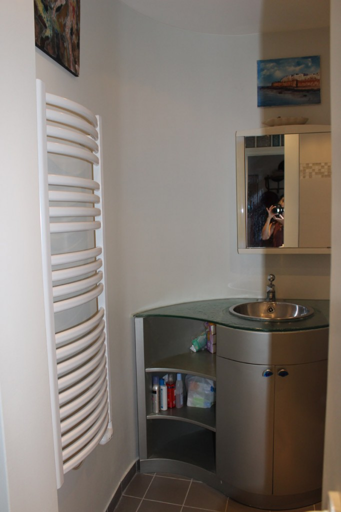 Acova wall mounted radiator with sink.