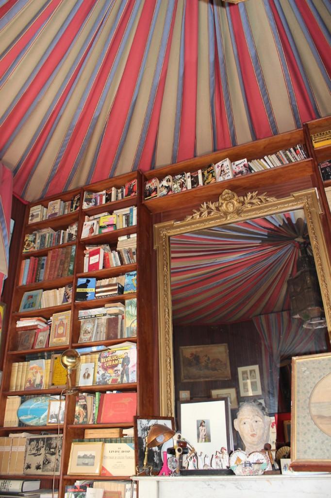 Mahogany bookshelves with Louis XVI gilded mirror