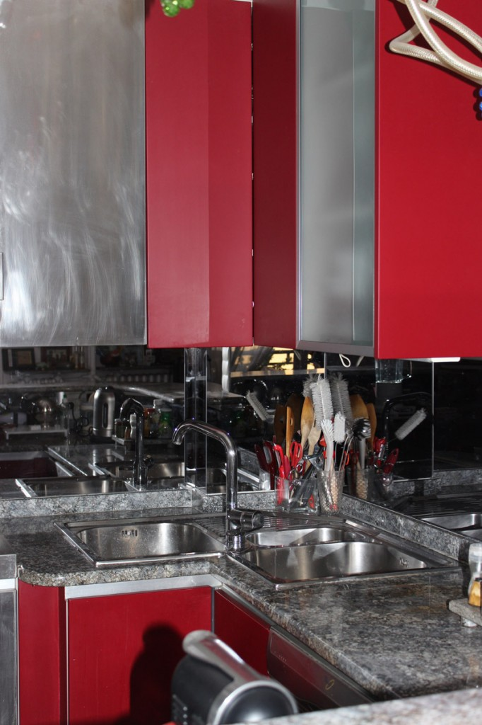 Kitchen cabinets with laminate, stainless steel and glass doors.