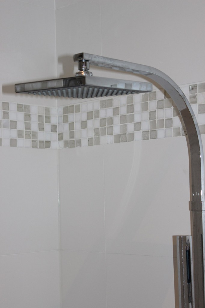 Shower head with wall mosaic design