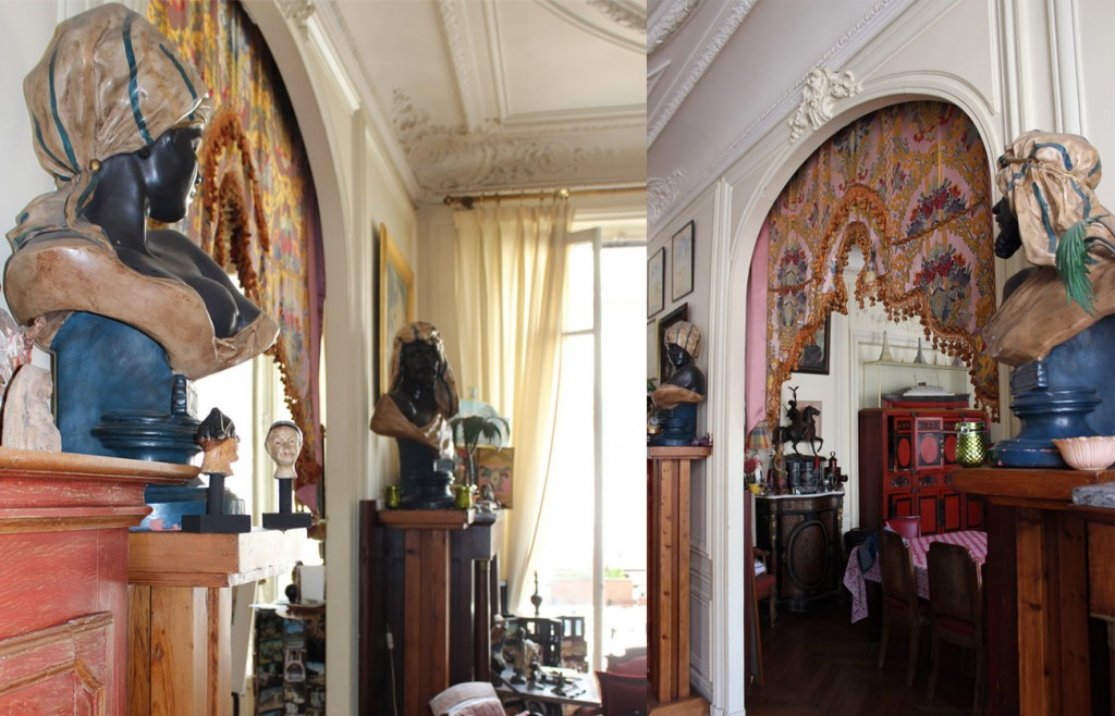 Busts with headdresses surrounding dining room opening