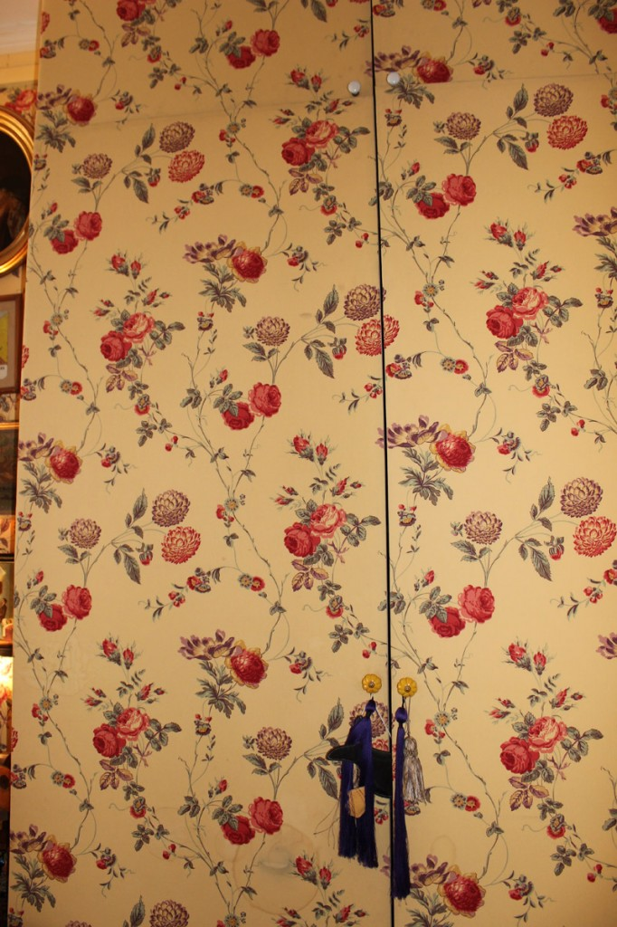 Entrance closet doors covered with wall fabric.