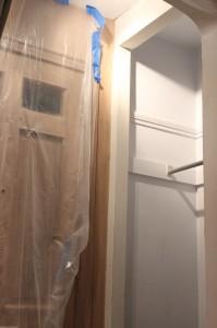 Enlarging door opening to fit taller door